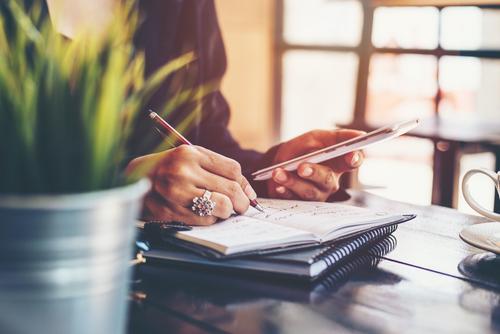 Desktop, making list – Steps to purchasing real estate