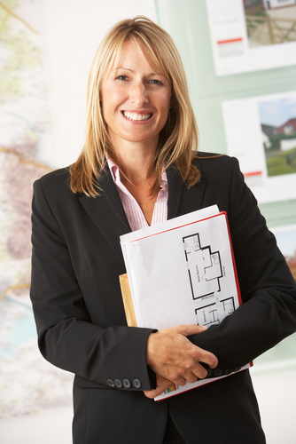real estate agent, friendly woman holding brochures