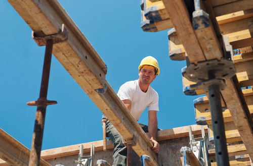 construction worker installing beam, Boise construction jobs