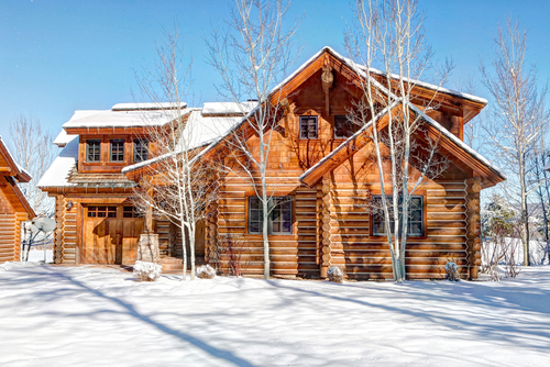 Idaho log cabin home in the snow – How to market your vacation rental