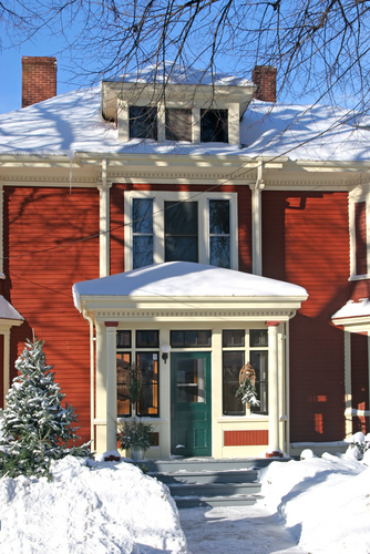 red house in snow, winter curb appeal