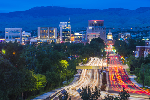 Boise, ID city skyline, night – Millennials are heading to smaller cities