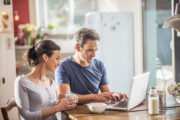 couple at laptop, kitchen table, loan application