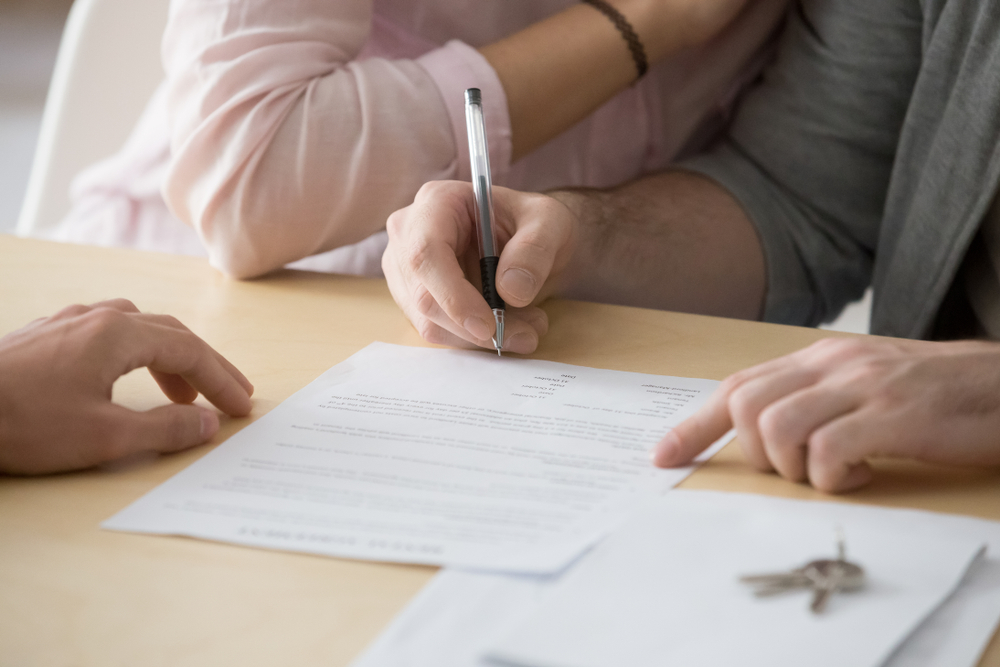 couple signing rental agreement, lease, idaho tenant laws