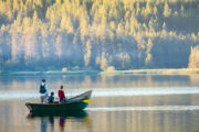 family in fishing boat, lake, trees, ldaho, best places to live