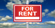 for rent sign, clouds in blue sky