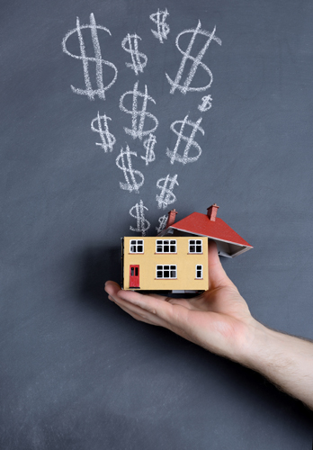 Hand holding small house, dollar signs – How to improve your real estate ROI