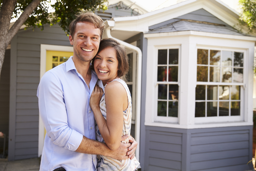 happy couple, new house, summer real estate market