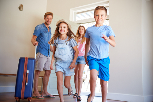 Happy family in vacation home – Increase Your Vacation Rental Property Income