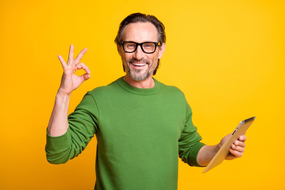 happy man with ipad, loan term checklist