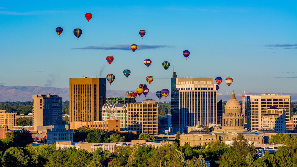 hot air balloons over Boise, Idaho skyline