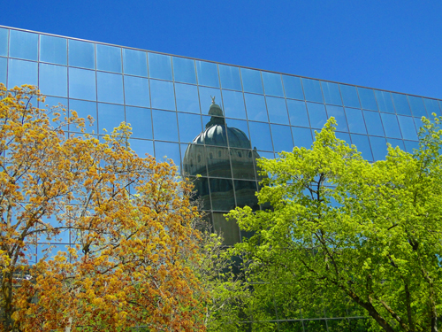 Idaho state capital reflected in downtown Boise building – Boise looks to future as green city