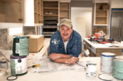 man painting, paint cans, messy kitchen remodel