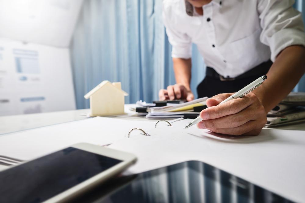 man applying for real estate loan, desktop
