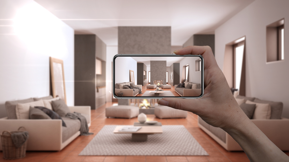 person taking photo of living room with smart phone, real estate listing