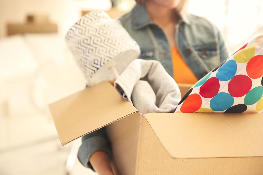 woman packing box, downsizing